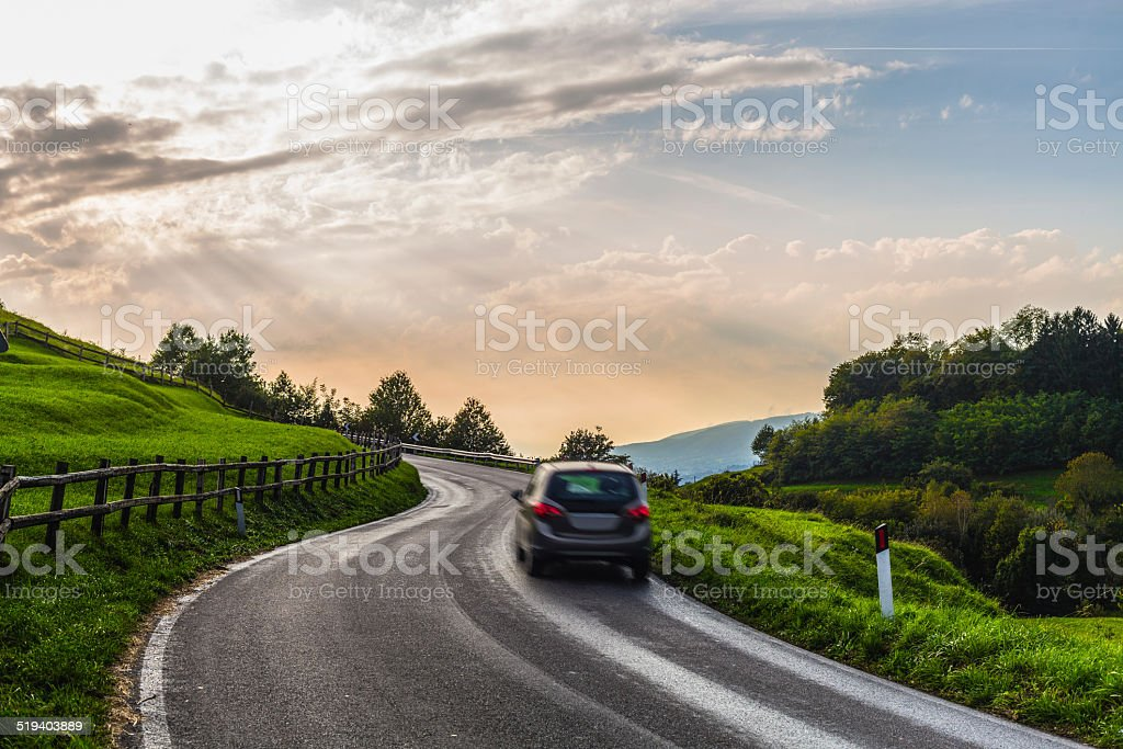 Car through a country road stock photo