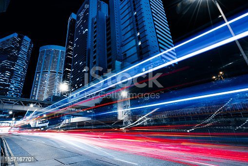 istock Car through street with blur light 1157167701