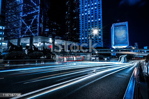 istock Car through street with blur light 1157167705
