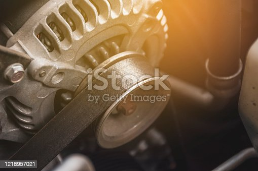 Car timing belt and alternator of engine system, automotive part concept.
