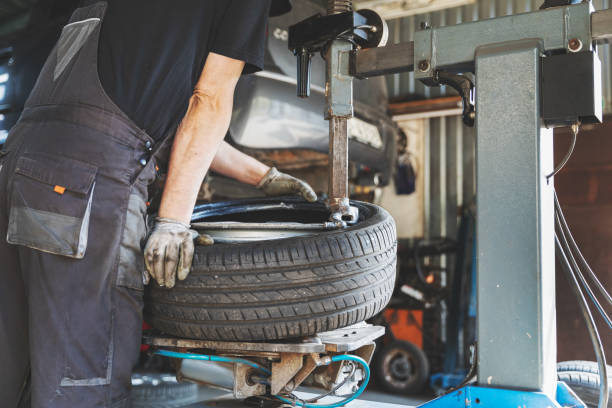 car tire change and repair service stock photo