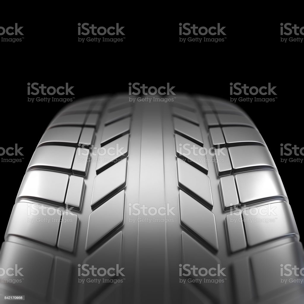 Car tire in close-up view on black background with stock photo