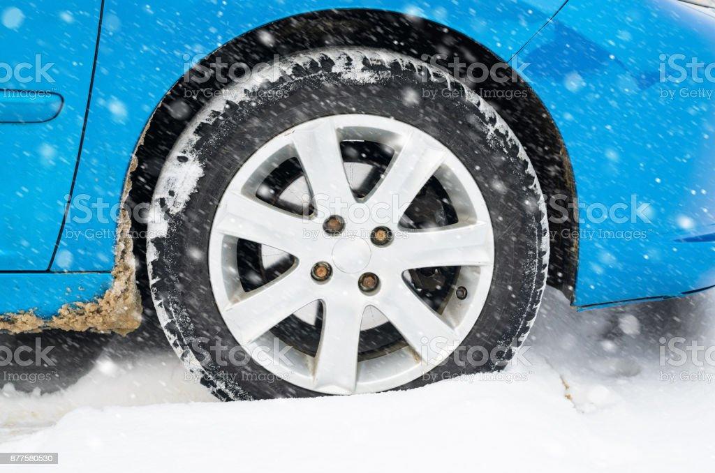 Car tire in the snow, winter concept stock photo