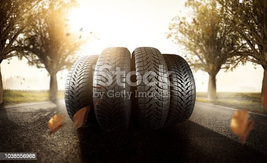 Car tire on an autumn road