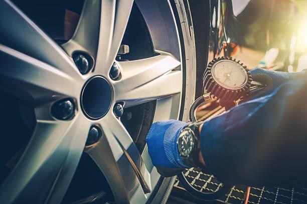Car Tire Pressure Check stock photo