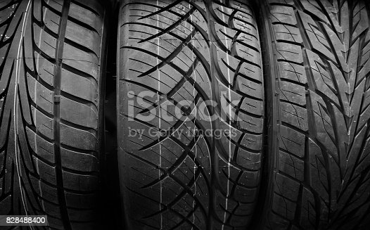 496485590istockphoto Car tire stack background.black and white 828488400