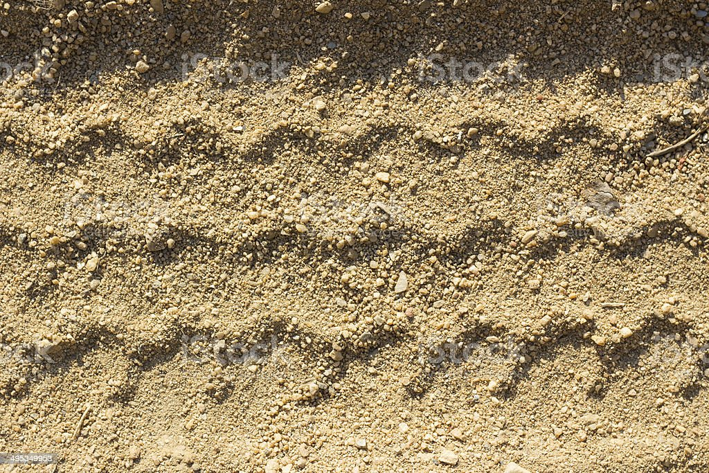 Car tire tracks on sand, as background stock photo