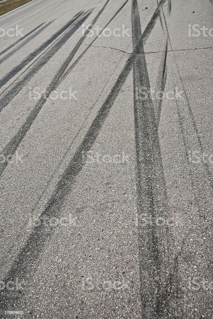 Car tire tracks on the street royalty-free stock photo