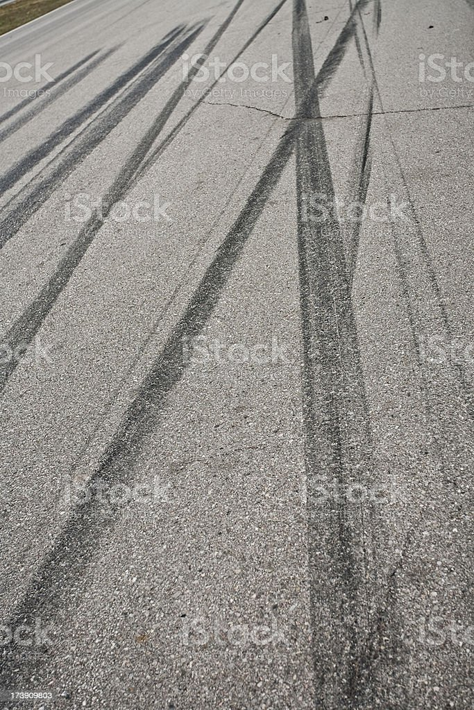 Car tire tracks on the street stock photo