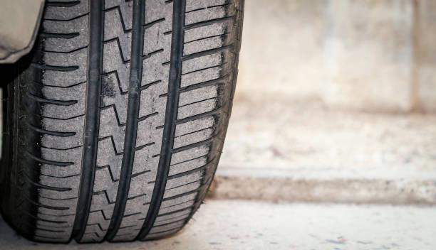 car tire tread and tread depth. vehicle tire exterior view stock photo