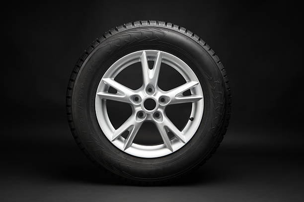 car tire with aluminum alloy wheel - wheel black background bildbanksfoton och bilder