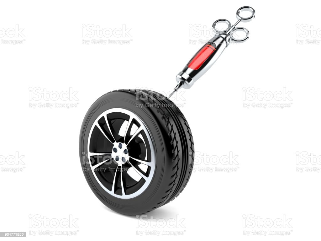 Car tire with syringe royalty-free stock photo