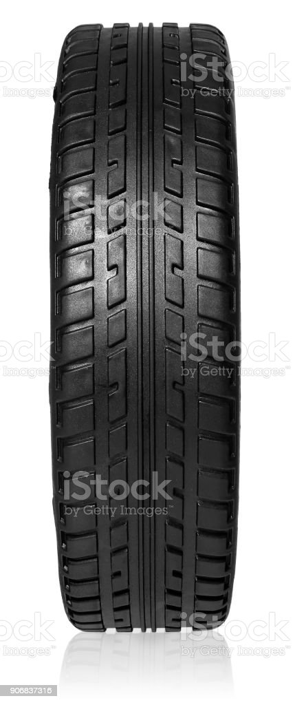 Car tire with tread forward. Rubber wheel isolated on white background with slight shadow. stock photo