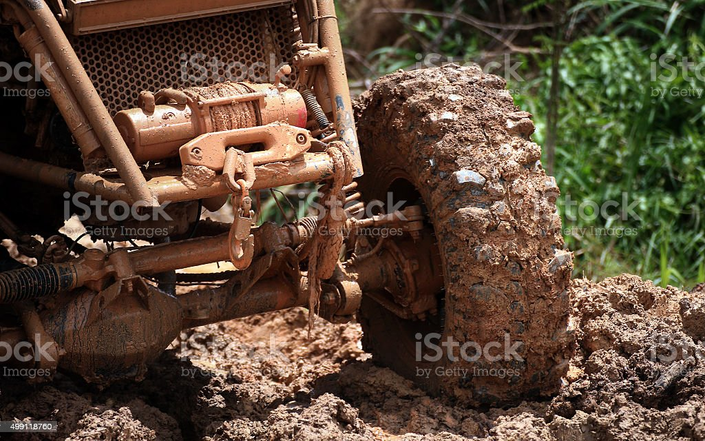 car tires and winch in dirt road stock photo
