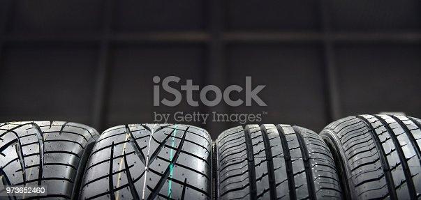 istock Car tires at warehouse 973652460