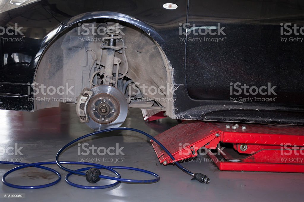 Car tires being removed and replaced in garage service stock photo