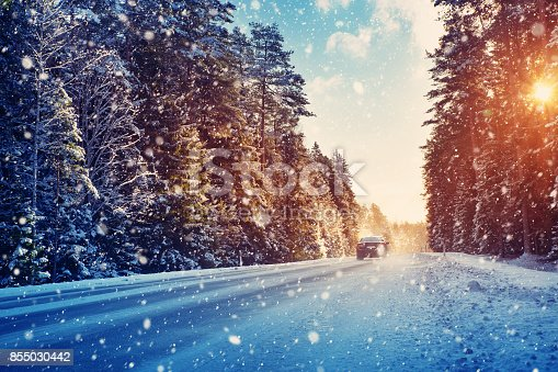 istock Car tires on winter road 855030442