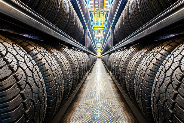 Car tires Car tires at warehouse vehicle part stock pictures, royalty-free photos & images