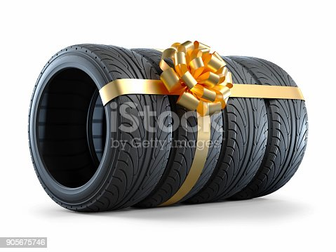 istock Car tires wrapped in a gift ribbon with a bow 905675746