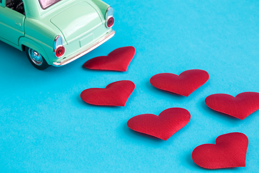 Miniature car with hearts minimal just married creative concept.