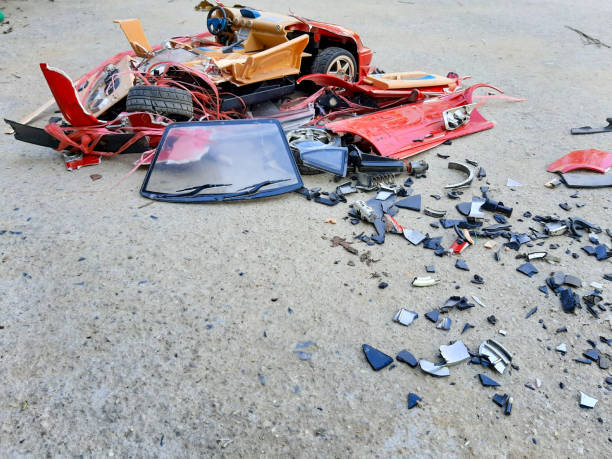 Car toy has accident hit and broken on the road - foto stock