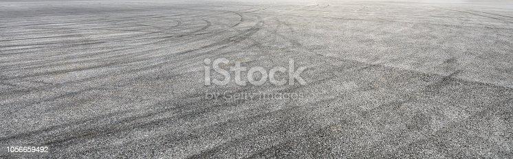 833130962istockphoto Car track asphalt pavement background at the circuit 1056659492