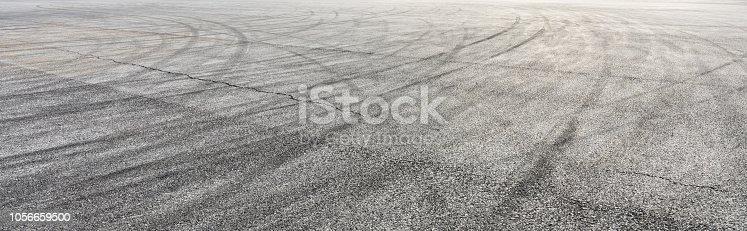833130962istockphoto Car track asphalt pavement background at the circuit 1056659500