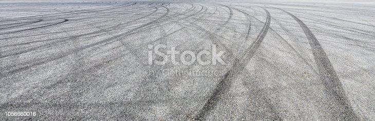 833130962istockphoto Car track asphalt pavement background at the circuit 1056660016