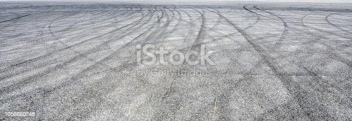 833130962istockphoto Car track asphalt pavement background at the circuit 1056660248