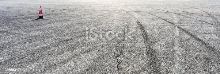 833130962istockphoto Car track asphalt pavement background at the circuit 1056660474