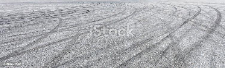 833130962istockphoto Car track asphalt pavement background at the circuit 1056662542