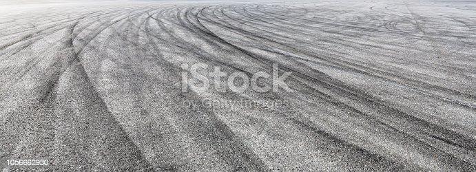 833130962istockphoto Car track asphalt pavement background at the circuit 1056662930