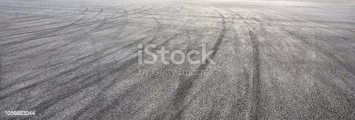 833130962istockphoto Car track asphalt pavement background at the circuit 1056663044