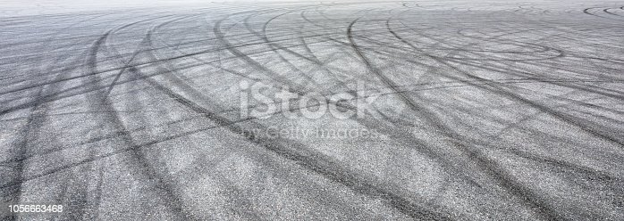 833130962istockphoto Car track asphalt pavement background at the circuit 1056663468