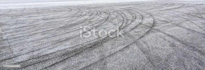 833130962 istock photo Car track asphalt pavement background at the circuit 1056665480