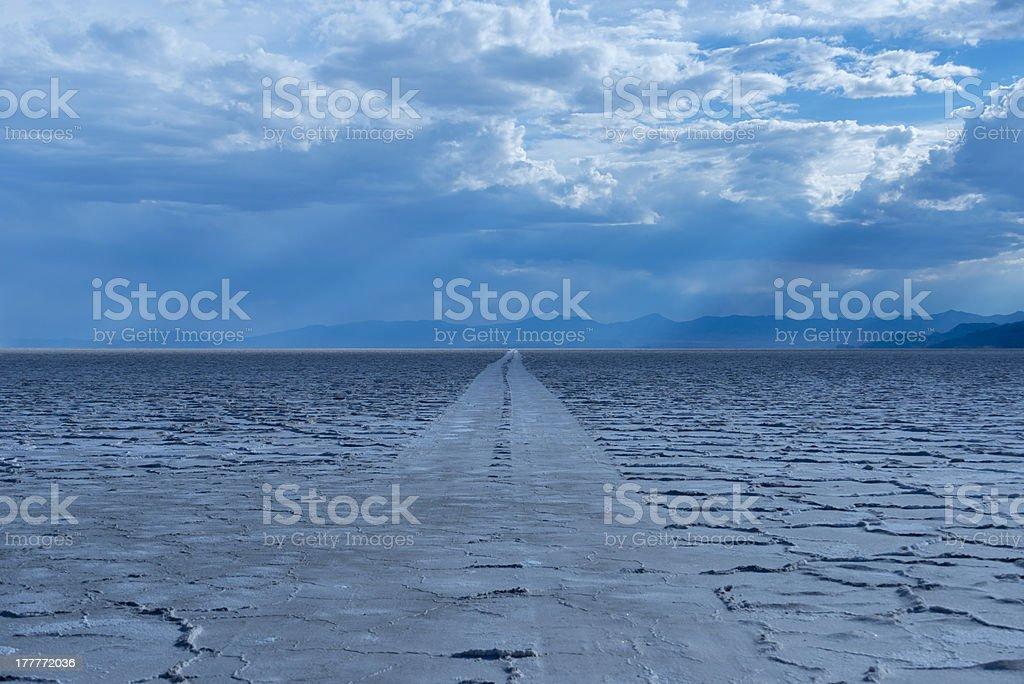 Car tracks on salt flats. stock photo