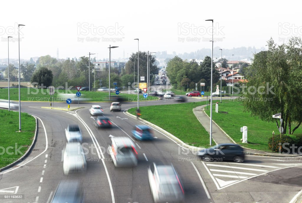 Car traffic around the roundabout stock photo
