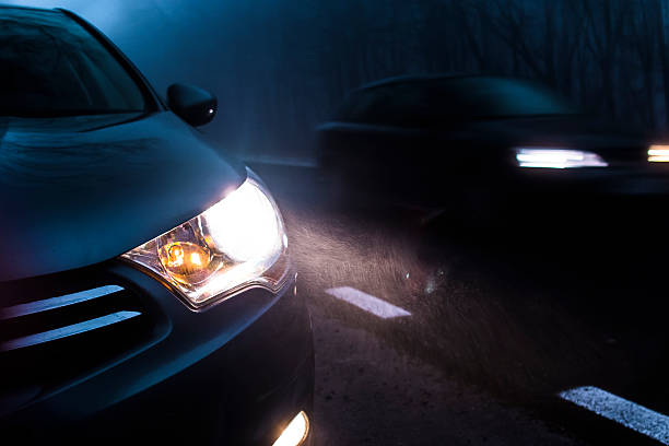 Car Traffic At Night Road traffic in the dark. headlight stock pictures, royalty-free photos & images