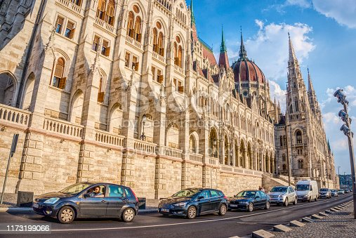 Budapest, Hungary - August 29, 2019: City panorama of Budapest, Hungary. Cars on the highway on the promenade and the facades of ancient government buildings. Business center at rush hour