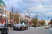 Berlin, Germany - December 8, 2017: Cityscape with car traffic on the road in Unter den Linden street in German City centre in Berlin with Fernsehturm tv tower