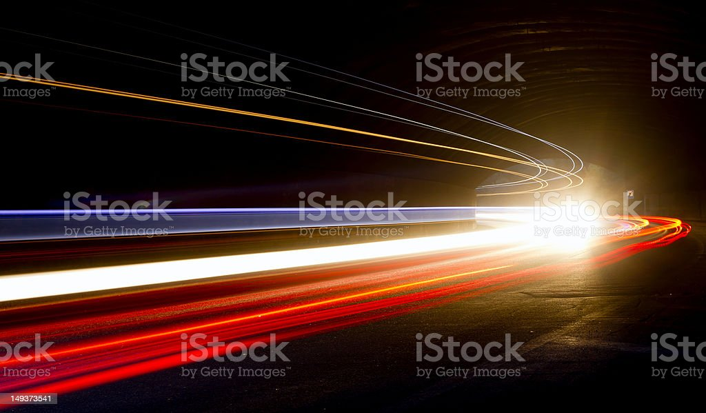A car trails bright lights in a tunnel stock photo