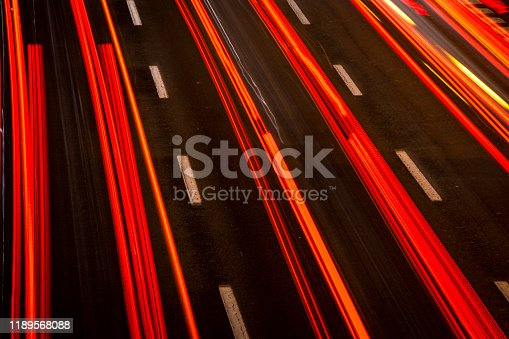 171150458istockphoto Car trails on the highway 1189568088