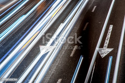 171150458istockphoto Car trails on the highway 1189568094