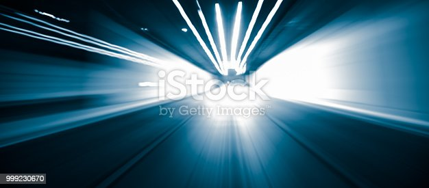 603907998 istock photo Car Trails with Neon Lights 999230670