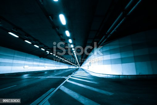 603907998 istock photo Car Trails with Neon Lights 999230830