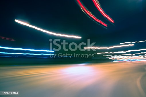 603907998 istock photo Car Trails with Neon Lights 999230844