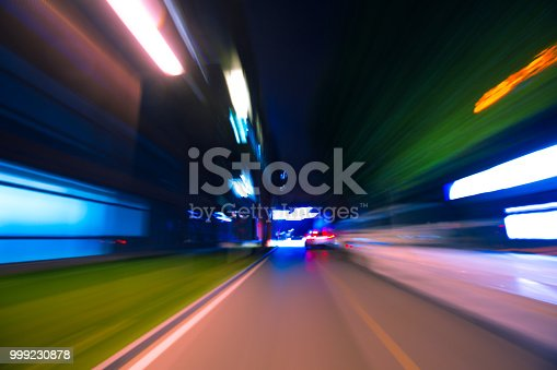 603907998 istock photo Car Trails with Neon Lights 999230878