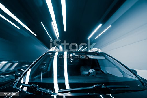 603907998 istock photo Car Trails with Neon Lights 999231070