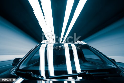 603907998 istock photo Car Trails with Neon Lights 999231168