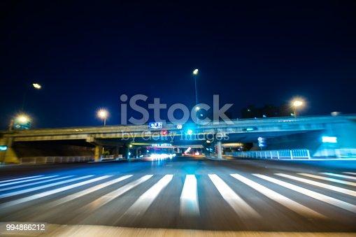 603907998 istock photo Car Trails with zebra crossing 994866212